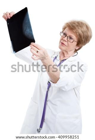 Elderly doctor radiologist examines x-ray image, isolated on white background - stock photo