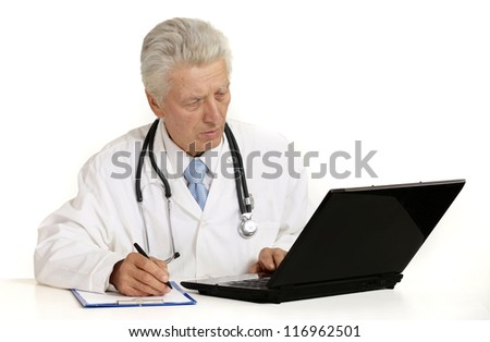 elderly doctor with a laptop on a white background