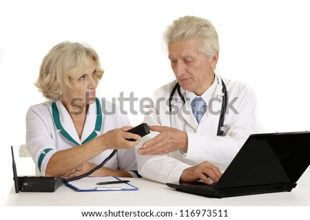 elderly doctors with a laptop on a white background - stock photo