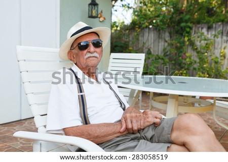 Elderly eighty plus year old man outdoor portrait. - stock photo