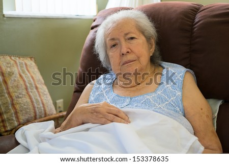 Elderly eighty plus year old woman in a home setting. - stock photo