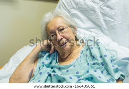 Elderly eighty plus year old woman in a hospital room setting. - stock photo