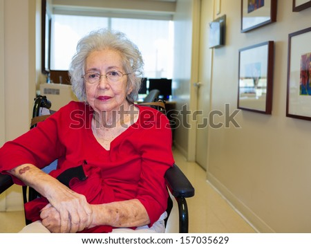 Elderly eighty plus year old woman in a medical office setting. - stock photo