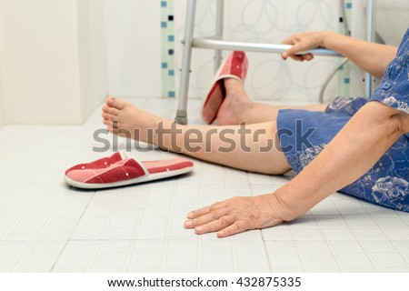 elderly fallling in bathroom because slippery surfaces - stock photo