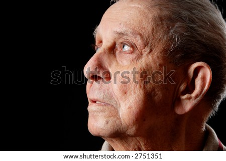 elderly grandfather on a black isolated background