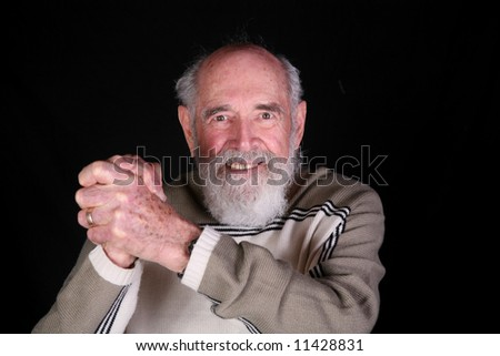Elderly grandfather with gray beard isolated on black background - stock photo