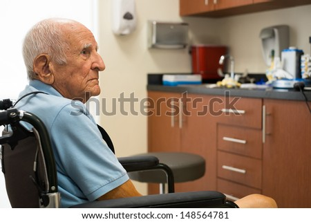 Elderly handicapped eighty plus year old man in a doctor office setting. - stock photo