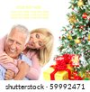 Elderly  happy couple near a Christmas tree. Isolated over white background - stock photo