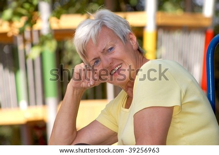 Elderly Lady outdoors - stock photo