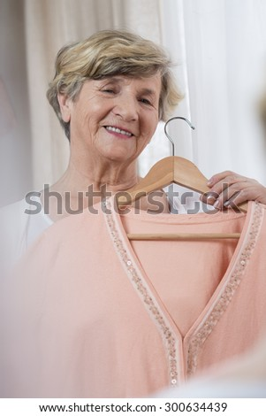 Elderly lady preparing herself for the meeting