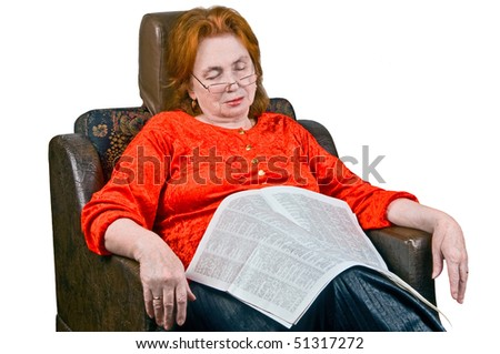 Elderly lady sleeping in an armchair - stock photo