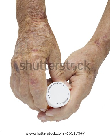 Elderly Male hand with severe disfiguring Rheumatoid Arthritis holding a bottle of pills - with clipping path - stock photo