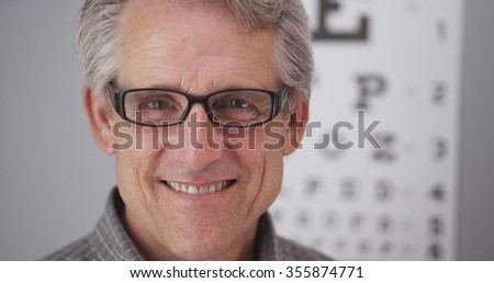 Elderly male wearing prescription glasses - stock photo