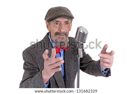 elderly male with raised hands talking into the microphone isolated on white background