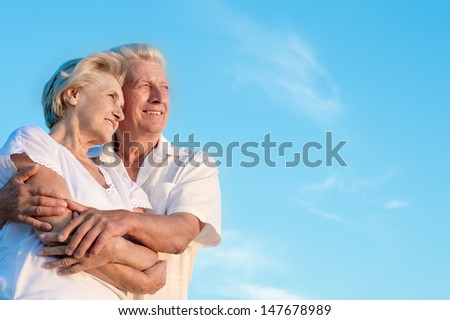 elderly man and an elderly woman resting together