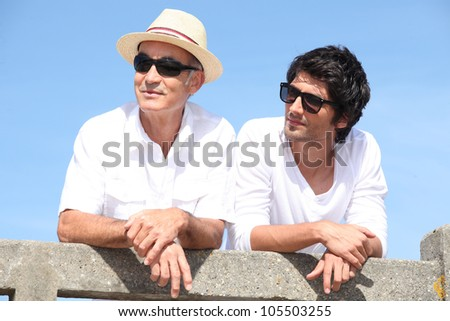 Elderly man and grandson - stock photo