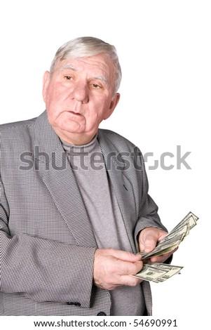 Elderly man considers money. Isolated on a white background - stock photo