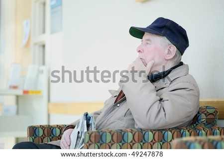 Elderly man deep in thought - stock photo