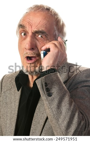 elderly man emotionally speaking on the phone isolated on white background