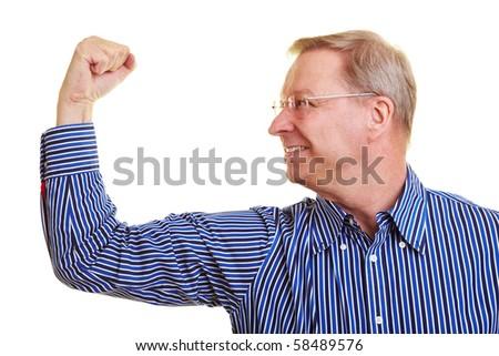 Elderly man flexing his upper arm muscles - stock photo