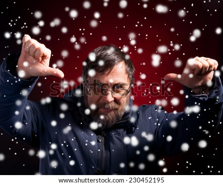 Elderly man gives thumbs down. Christmas and holidays concept