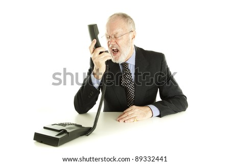 Elderly man having angry phone call and screaming back on white background