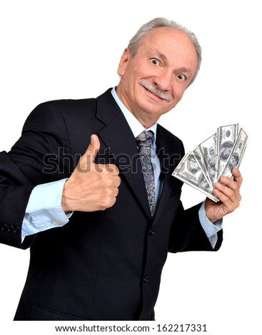 Elderly man holding dollars and showing yes sign - stock photo