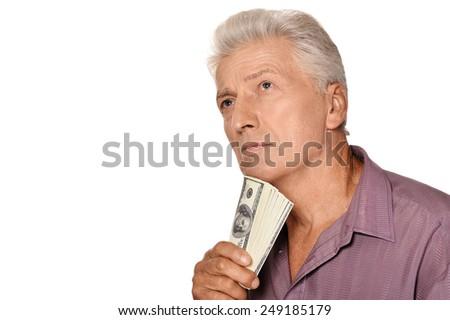 Elderly man holding dollars on white background - stock photo