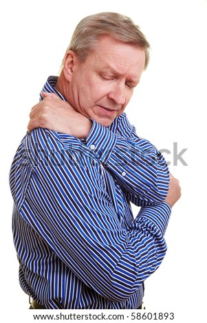 Elderly man holding hands to his aching back - stock photo