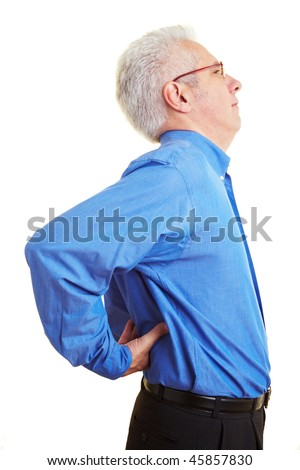 Elderly man holding his hands on his aching back