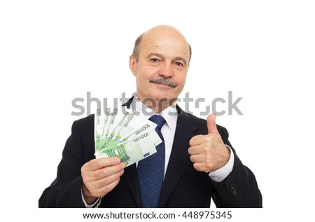elderly man in a suit holding money and showing thumbs up - stock photo