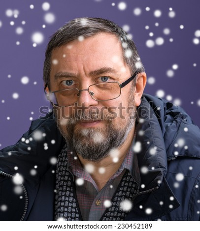 Elderly man in glasses. Christmas and holidays concept