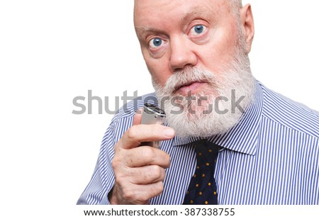 Elderly man is speaking to voice recorder on white background, color and contrast manipulated - stock photo