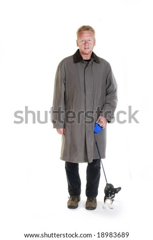 Elderly man is walking his little Chihuahua