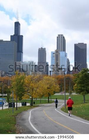 elderly man jogging towards Sears Tower Chicago - stock photo