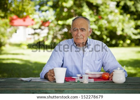 Elderly man lost in thought - stock photo