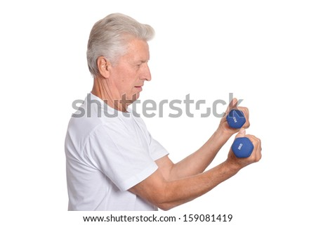 elderly man playing sports on a light background - stock photo