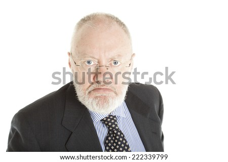 Elderly man posing on white background as grumpy guy - stock photo