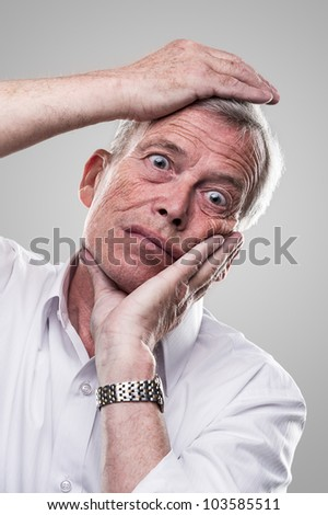 Elderly man puts his head in place - stock photo