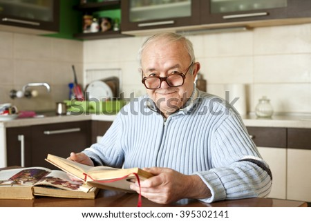 elderly man reading a book - stock photo