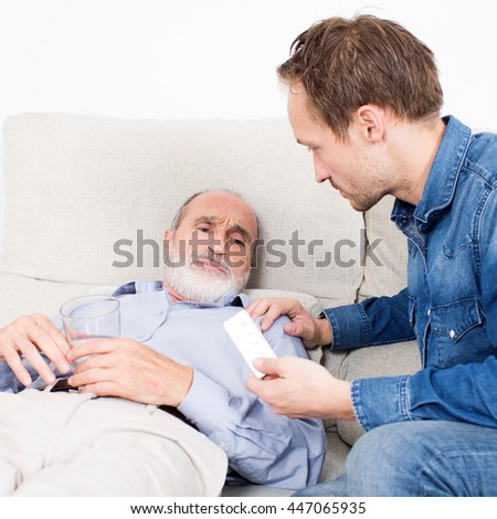 Elderly man receiving some medicine