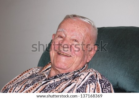 Elderly man relaxing and smiling. - stock photo