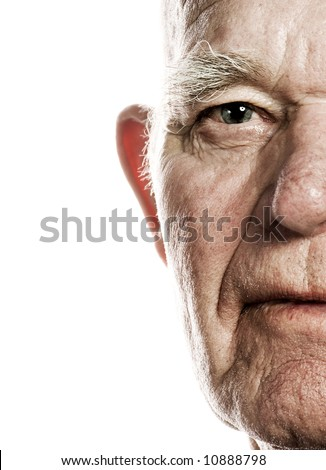 Elderly man's face over white background - stock photo
