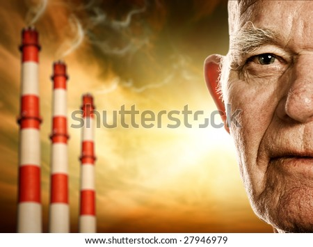 Elderly man's face. Power plants on background - stock photo