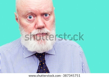 Elderly man, senior, is posing on blue background, color and contrast manipulated