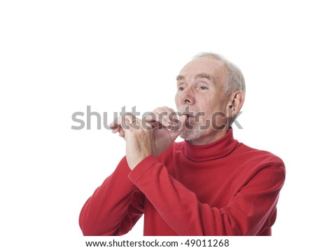 Elderly man shaping his hands as if to blow a horn. Proud of success, his or other's.