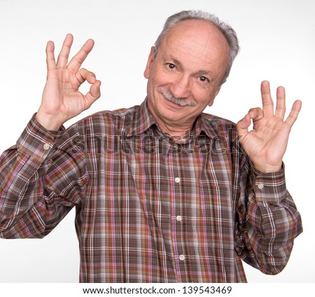 Elderly man shows ok sigh on a white background
