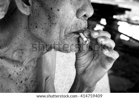 Elderly man smoking ,vintage tone - stock photo