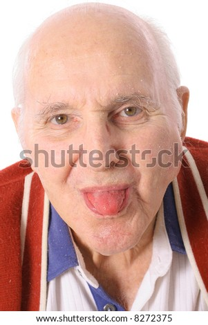 elderly man sticking out his tongue - stock photo