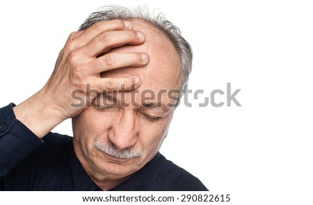 Elderly man suffering from a headache isolated on white background with copy-space  - stock photo